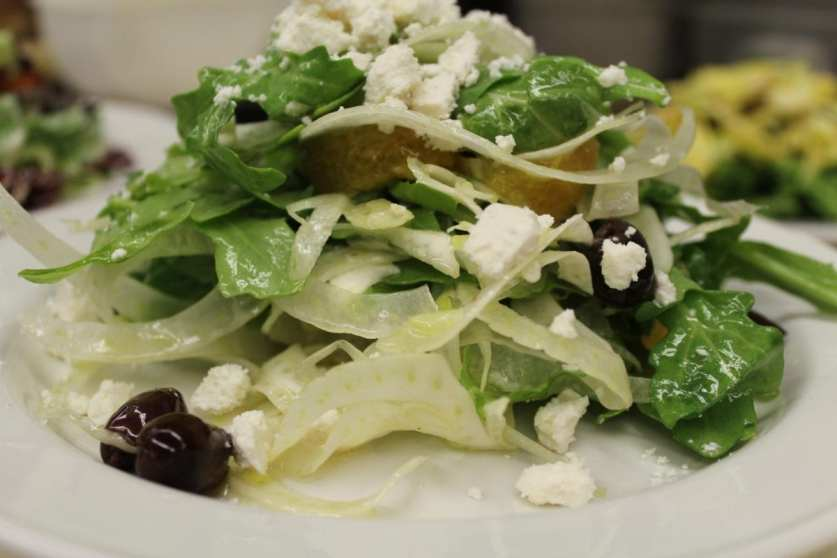 Local Arugula and Fennel Salad with Taggiasca Olives from Liguria and Ricotta Salata