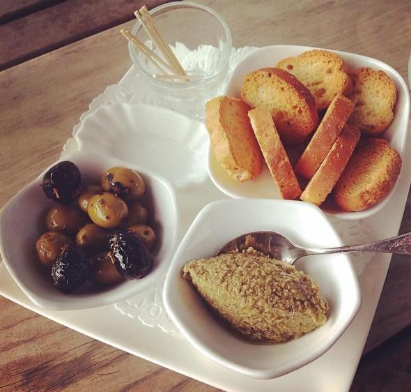 Olives served with cocktails, Boulbon, France.