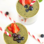 top shot of two green smoothies in glasses with red and white striped straws