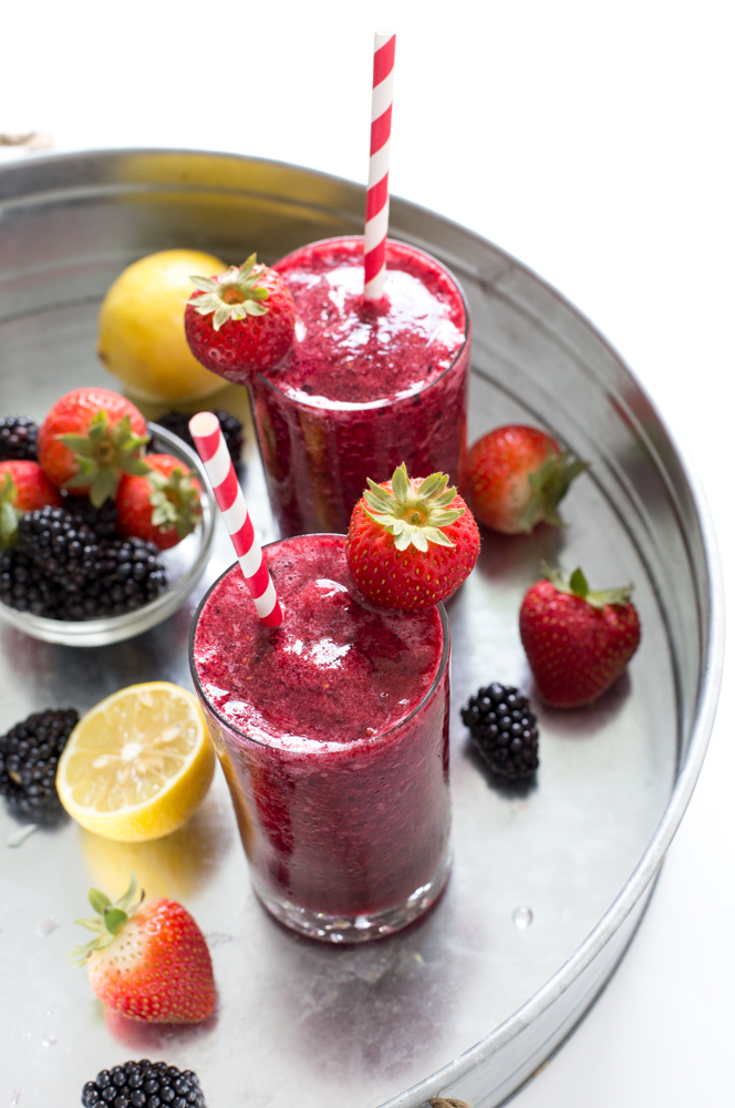 Top shot of frozen mixed berry lemonade in glass cups.