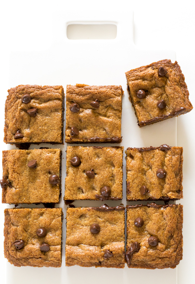 Browned Butter Chocolate Chip Blondies cut into squares on white cutting board
