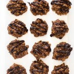 Top shot of no bake chocolate cookies in rows on white cutting board.