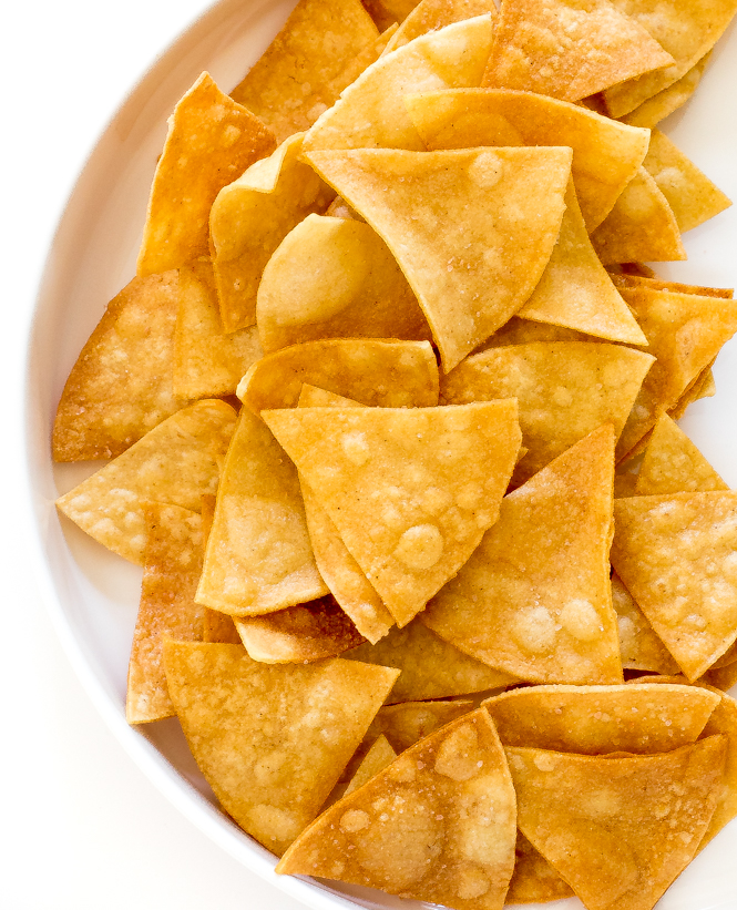top shot of homemade tortilla chip triangles in white dish