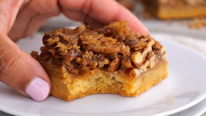 Pecan Pie Bars served on a white plate | chefsavvy.com