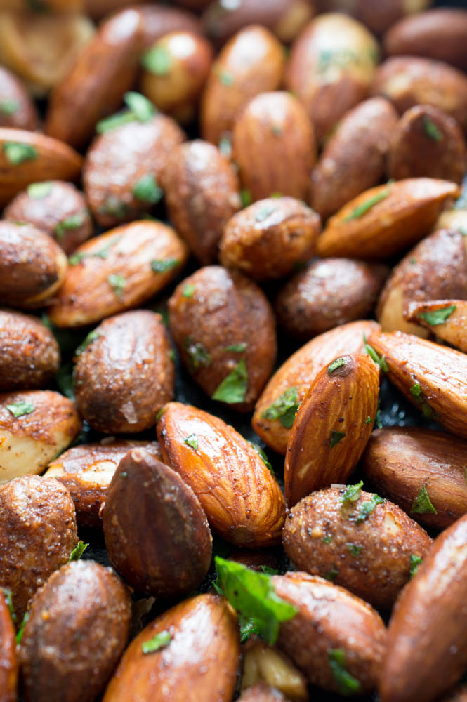 close up shot of nuts with cilantro flakes