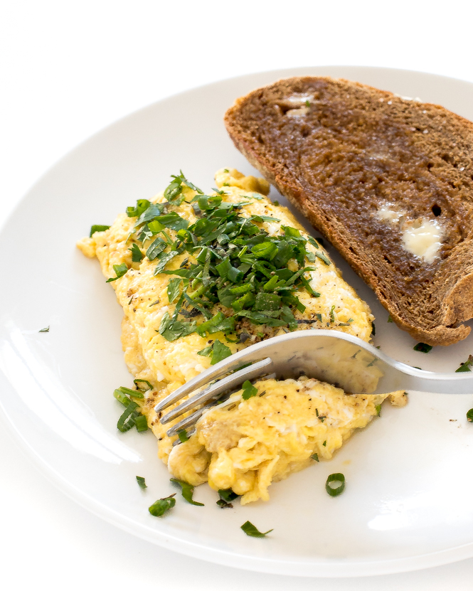 scrambled eggs sprinkled with tons of fresh herbs