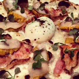 "A neapolitan pizza I made for my sous chef ""Remington Ho."" Sea urchin, guanciale, fonduta, 63* egg."