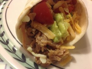 Wrap some in a warn tortilla with avocado, salsa and a little shredded monterey jack and cheddar cheeses.