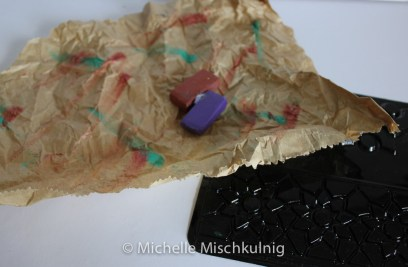 add some texture with waxed crayons.