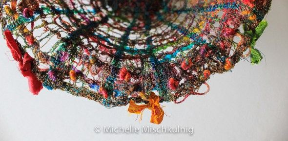 I embellish mine with some hand stitch in hand dyed threads and little sari ribbon ties.
