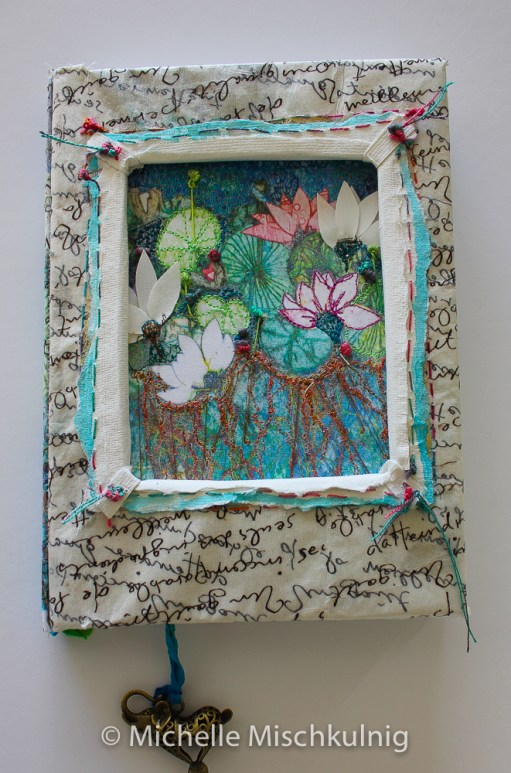 AS you can see form this image I used hand made paper to form a frame around the art work tow layers one layer being tucked under the internal front edge of the window and the other layer having some hand stitching .I also added a little water colour paint to the edge.