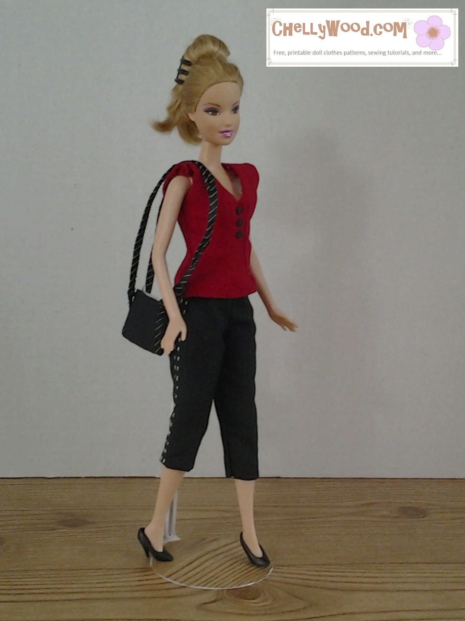 Visit ChellyWood.com for free, printable sewing patterns for dolls of many shapes and sizes. Image shows fashion doll wearing hand-made capri pants, sleeveless summer shirt, and carrying a strappy purse. If you'd like to make this outfit, please click on the link in the caption. It will take you to the page with the free patterns and tutorial videos for making this summer outfit.