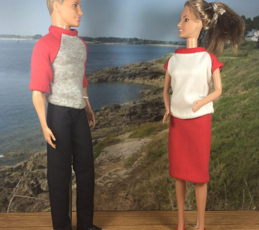 Image shows Ken doll wearing black jeans or pants and a red and grey raglan-style T-shirt. He stands next to a Barbie doll who wears a raglan-sleeved T-shirt with a pencil-style knit skirt. They appear to be chatting on a boardwalk overlooking an ocean view. The sky is sunny behind them. Visit Chelly Wood Dot Com for more free, printable sewing patterns like this one.