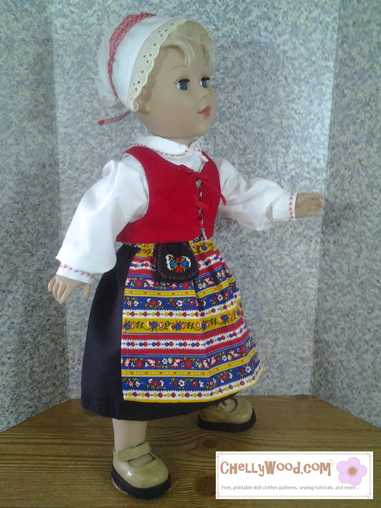 """In this photograph, a Madame Alexander 18 inch doll models a traditional Swedish costume. This costume includes a little bonnet, a shirt with a collar and cuffs, a lace-up vest, a black skirt, and a folk apron. There's also a traditional Swedish """"pocket purse"""" made of embroidered felt attached to the waistband of the apron. Although it's not pictured here, the costume also includes a neckerchief."""