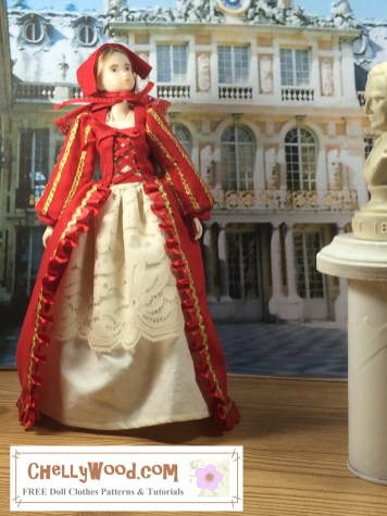 The image shows a Momoko doll wearing a renaissance gown with shift and bonnet. The doll stands in a foyer or atrium with statues and columns all around her. Her dress is decorated in ribbons and ruffles. Her shift is lacy. If you'd like to make these doll clothes for your Momoko doll, please click on the link in the caption for the free printable sewing patterns and tutorial video for sewing these doll clothes.