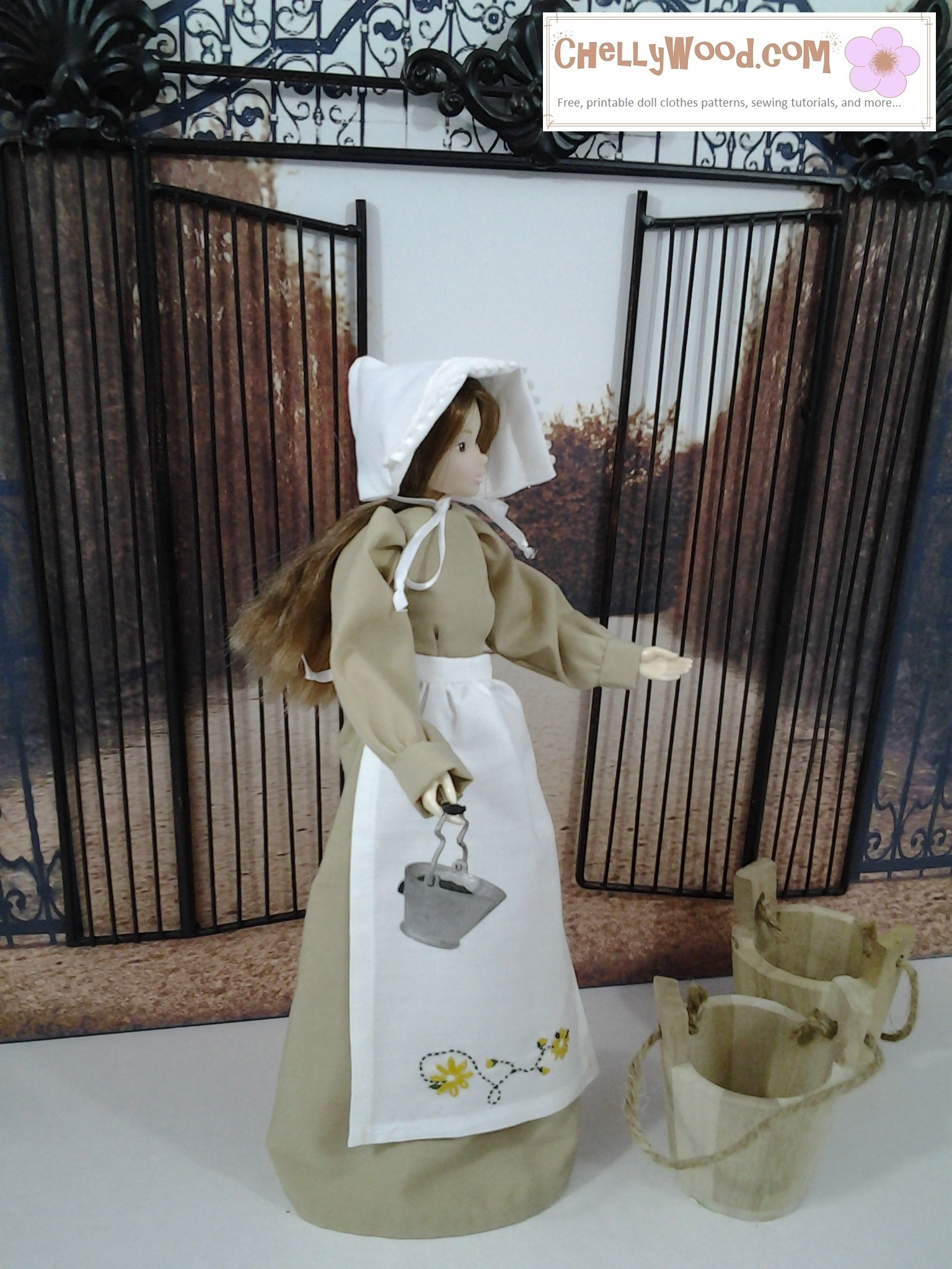 The image shows a Momoko doll in a dress, apron, and bonnet. The apron is embroidered with tiny flowers and leaves. If you'd like to make these doll clothes, please click on the link in the caption for free printable sewing patterns and tutorial videos for making these doll clothes.