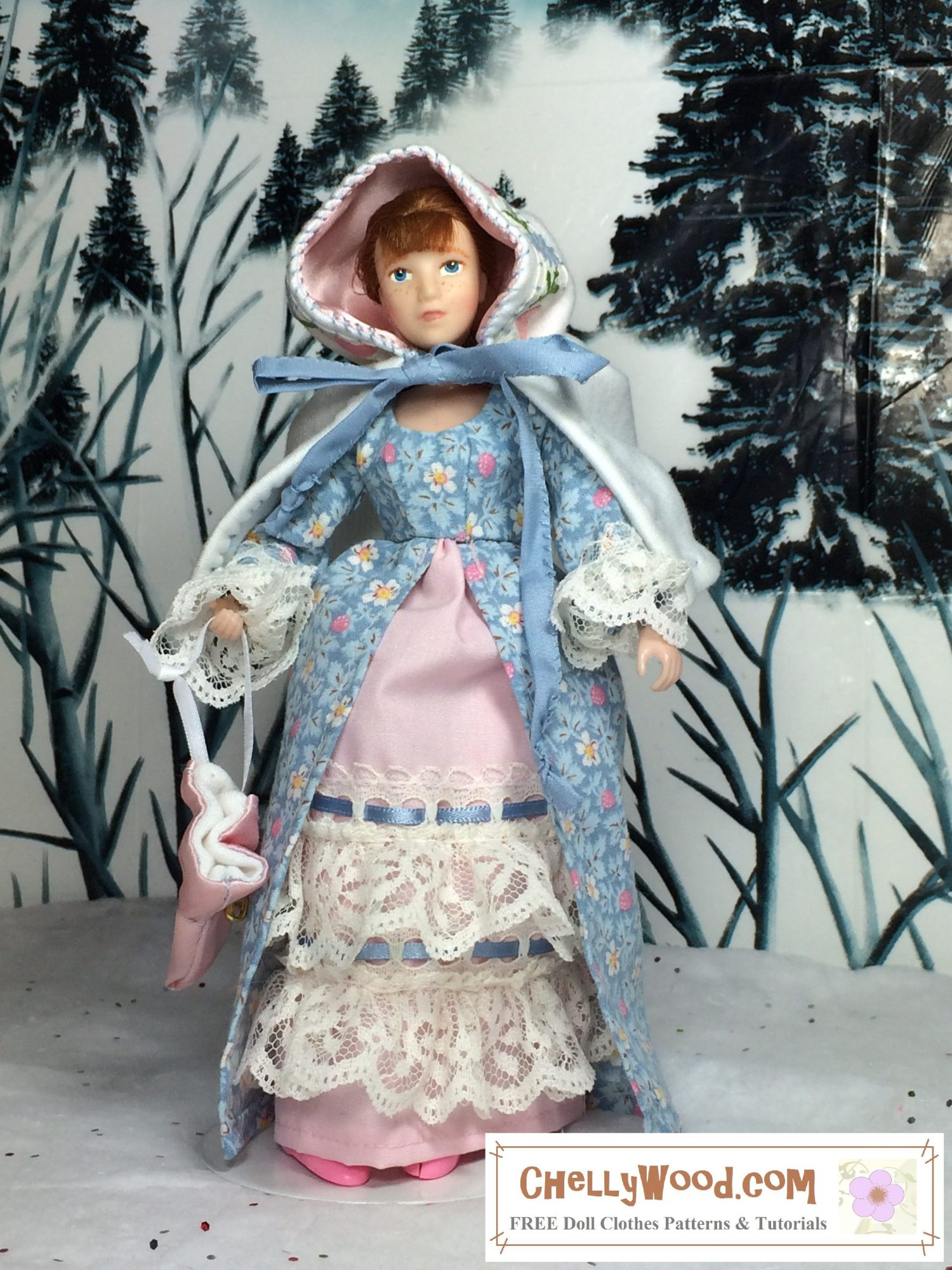In a winter setting with snow all around, an 8 inch Breyer Rider figure with auburn red hair holds a pink satin drawstring purse. She wears a short riding hood style cape made of white cotton jersey fabric with pink satin hood lining and embroidery around the edge of the hood. She also wears a pretty blue dress with pink flowers and a pink petticoat that's trimmed in white lace and blue ribbons. We're not able to see it in the photo, but she also wears lacy bloomers under her petticoats. Her pink shoes peek out under the long skirt of her dress.