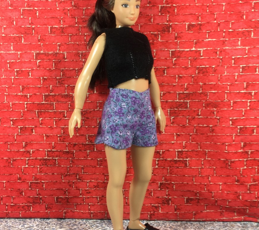 The image shows a Lammily doll wearing a pair of handmade cotton shorts with a felt crop top. Click on the link in the caption to navigate to a page where you can download the free printable PDF sewing patterns for making these doll clothes to fit your Lammily doll.