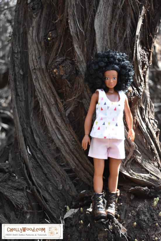 "Lammily.com's ""Photographer"" doll is seen posing for pictures in a magical forest landscape."