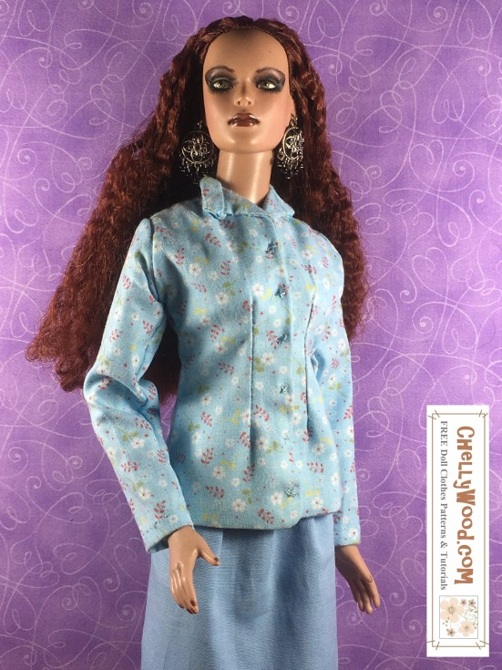 """Visit ChellyWood.com for free, printable sewing patterns and tutorials for dolls of many shapes and sizes. Image shows a Tonner doll wearing a hand-sewn business suit made of a solid blue fabric skirt and a floral blue-and-white blouse or business-style jacket with collar and front darts. Overlay says, """"ChellyWood.com: Free printable patterns for dolls of many shapes and sizes."""""""