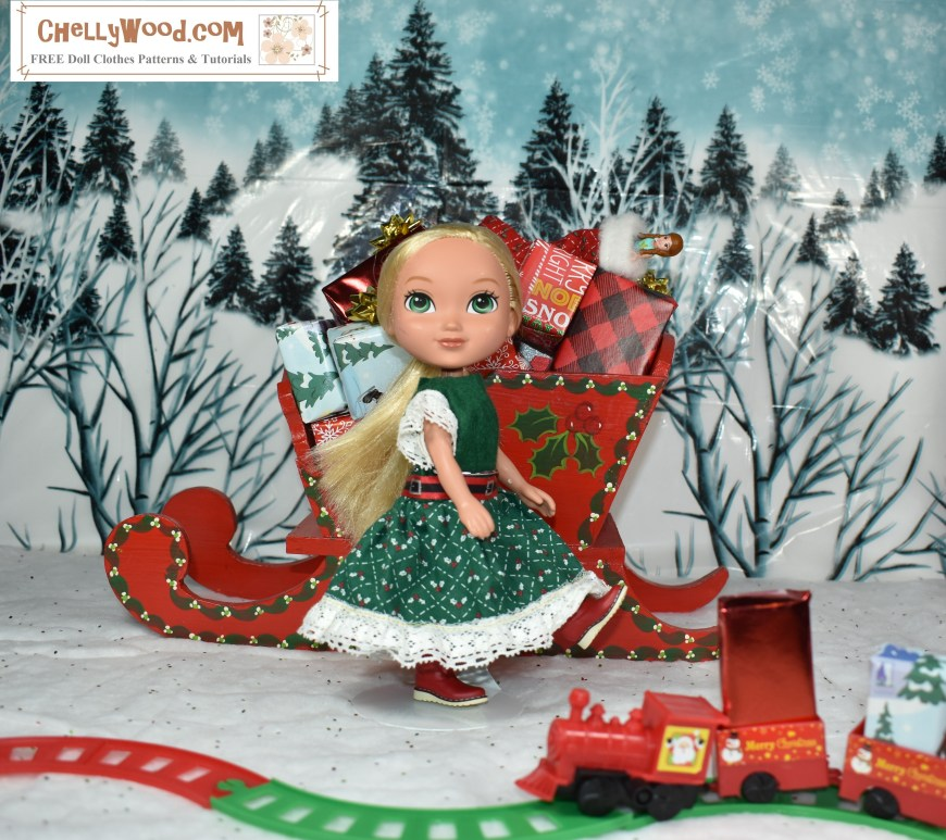 Dora the Explorer's little friend Alana stands big-eyed in a North Pole diorama. Snow is all around her, and Santa's sled, loaded with toys and packages, is right behind her where she stands in the snow. In front of Alana, we see a tiny train on a miniature train track which carries more packages toward Alana, who looks a lot like an elf in her handmade green Christmas dress made of a green felt bodice and a green floral cotton skirt with eyelet trim.