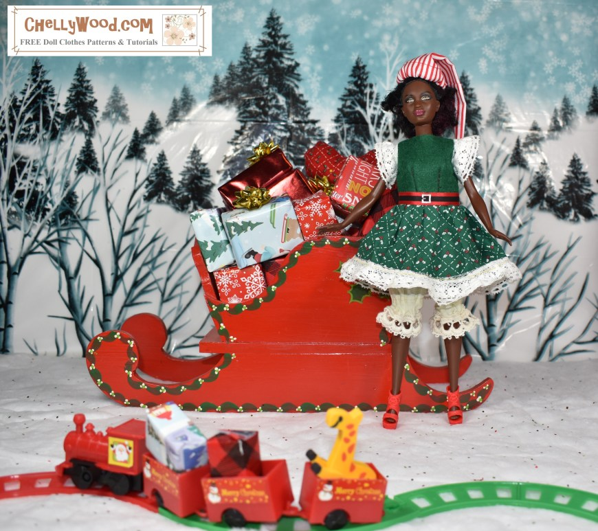 Please visit ChellyWood.com for free, printable sewing patterns for dolls of many shapes and sizes. Image shows a petite Barbie from the Fashionista line dressed in a hand-made Christmas dress and elf hat. She stands before a tiny train filled with gifts and toys. She leans against Santa's sleigh, which is filled with little wrapped gifts. Behind her is a snow-covered hill with many wintery pine trees.