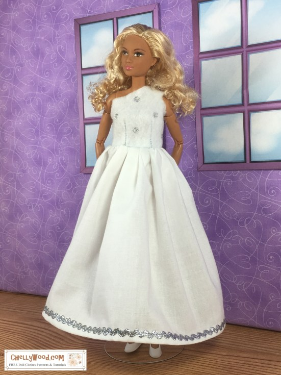 "Image shows a made-to-move Barbie from Mattel wearing a handmade wedding gown. She looks away from the camera, and her hands are held behind her back, enhancing the fullness of her wedding dress's skirts. The bodice of the gown, which is made of felt, covers one of the doll's shoulders, leaving the other exposed. The bodice is spotted with silver polka dots. The skirt is pure white and gathered, with a silvery rick-rack decorating the bottom of the skirting. Her tiny white flat shoes peek out from under the long wedding gown. She stands before a purple wall that has two simple windows looking out at a cloudy sky. The doll's hair is blond with curls, and the overlay says, ""ChellyWood.com: FREE printable sewing patterns and more."""