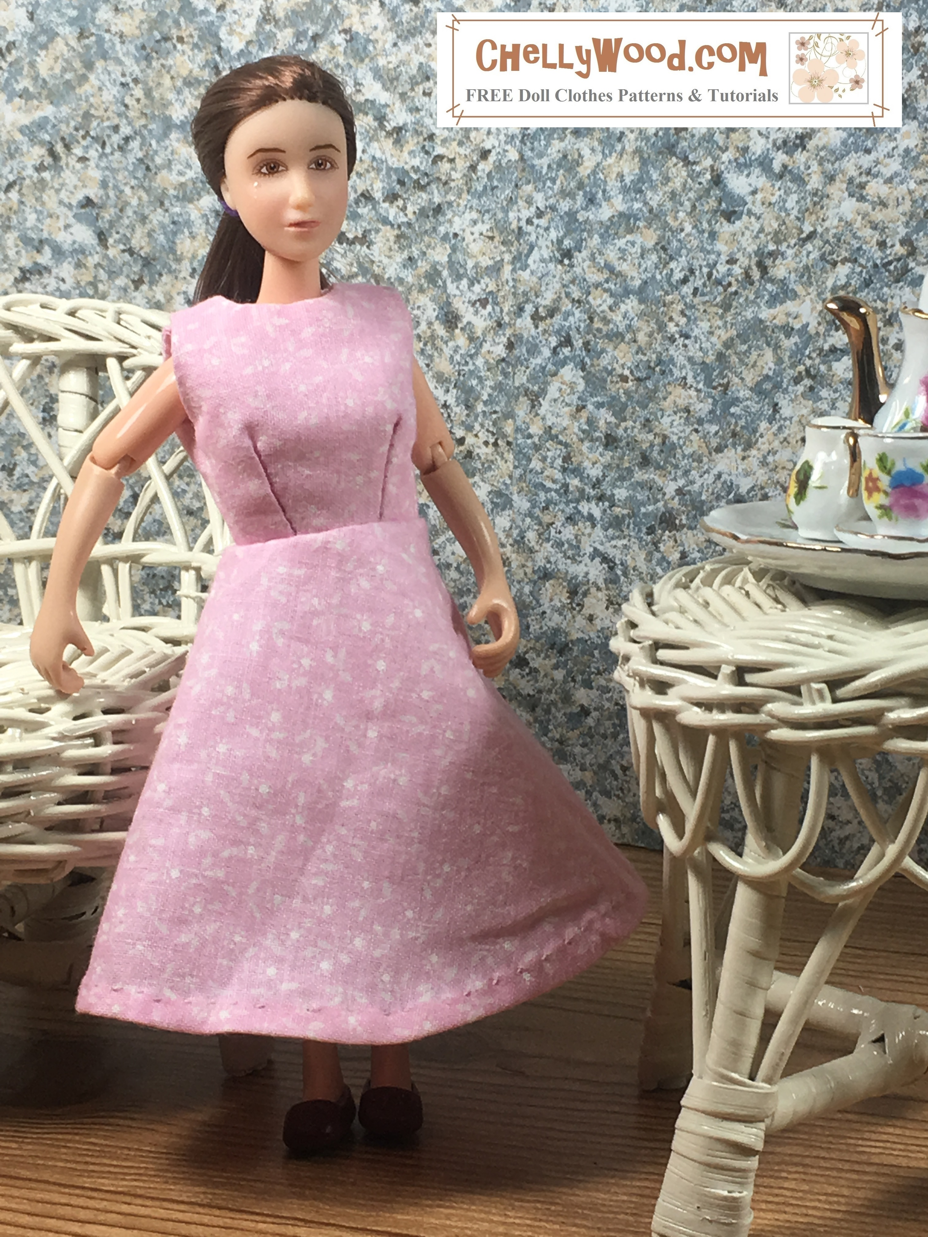 """Click here for all the patterns and tutorials you'll need to make this dress: https: https://wp.me/p1LmCj-GOj Image shows 6"""" Breyer Rider doll wearing an handmade A-line dress and standing in a 1:6 scale diorama that shows the bust of a musician, a classical painting, and is decorated with a wicker table and chair. On the table is a 1:6 scale porcelain tea set for little dolls. The 6"""" Breyer Rider doll wears a dress that has been sewn by hand. Overlay offers the sewing tutorials and free doll clothes patterns website: ChellyWood.com and states that this website has free doll clothes patterns and tutorials for dolls of many shapes and sizes."""