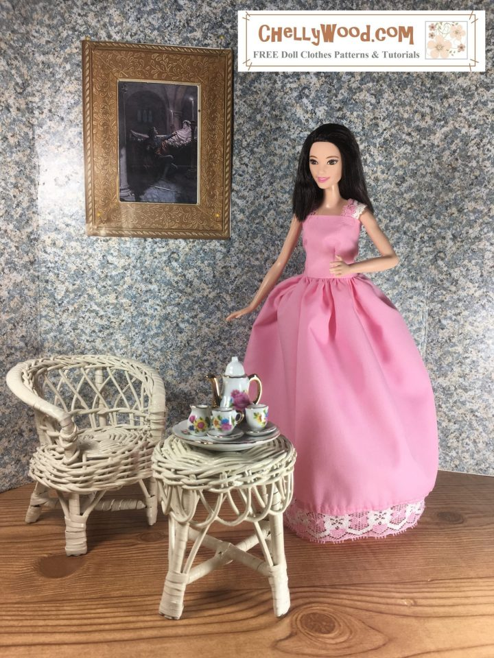 Tall Barbie wears a pink Quinceanera Dress with white and pink lace trim. She stands alone in an empty ballroom. In front of her, a small wicker table holds a miniature tea set decorated with tiny pink flowers. To her right is a white wicker chair. Behind her, hanging on the wall, is a gold framed painting of Romeo and Juliet.