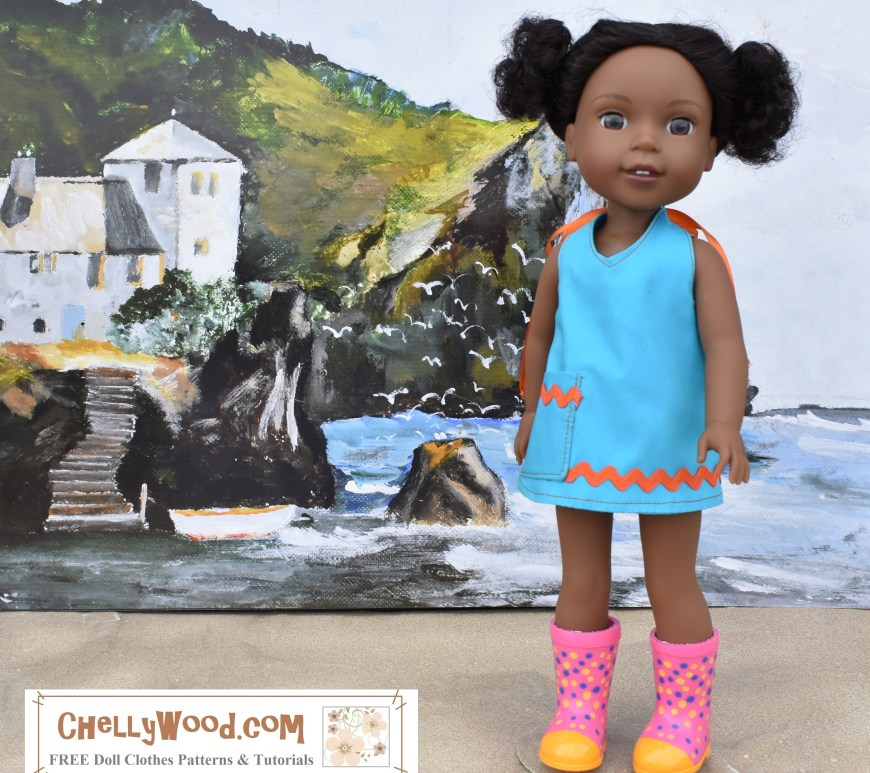 "Image shows a Wellie Wisher doll from the American Girl doll collection wearing a handmade halter-style summer shirt, dress, or swimsuit cover-up garment with rickrack and a pocket. The doll stands in front of a painting of a beach scene with a vacation house on a cliff overlooking the ocean. The doll's rubber boots keep her feet dry as she stands on a sandy surface. Overlay reads: ""ChellyWood.com: FREE printable sewing patterns and tutorials for dolls of many shapes and sizes."" Please visit ChellyWood.com for free, printable sewing patterns for doll clothes to fit this and other sized dolls."