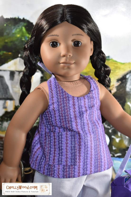 """The image shows the American Girl Doll Kaya wearing the doll clothes we are making at ChellyWood.com using Chelly's free printable American Girl doll clothes patterns. This week's free pattern will be for an 18 inch doll shirt. It's a summer shirt, shown on her Kaya doll from the American Girls doll company. This doll's shirt pattern includes a front pocket, ribbon ties at the neck, and remember, the pattern for this halter-style summer tank top is free, printable, and relatively easy to sew. The watermark on the image reminds you that free American Girl doll clothes patterns can be found at ChellyWood.com (free AG doll clothes patterns and free Madame Alexander doll clothes patterns fit most 18"""" dolls)."""