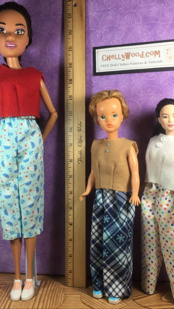 The image shows a vintage Tammy doll dressed in handmade clothes. The same clothing patterns are worn by a MTM Barbie and a 17-inch Barbie. On the MTM Barbie, the pants look too big, but on 17 inch Barbie, the Tammy doll pants seem to fit well as capri pants. The dolls stand next to a ruler, showing Tammy dolls to be about 11.5 inches tall, and on the wall behind the dolls, a website is cited: ChellyWood.com, the home of hundreds of free sewing patterns for dolls of many shapes and sizes.