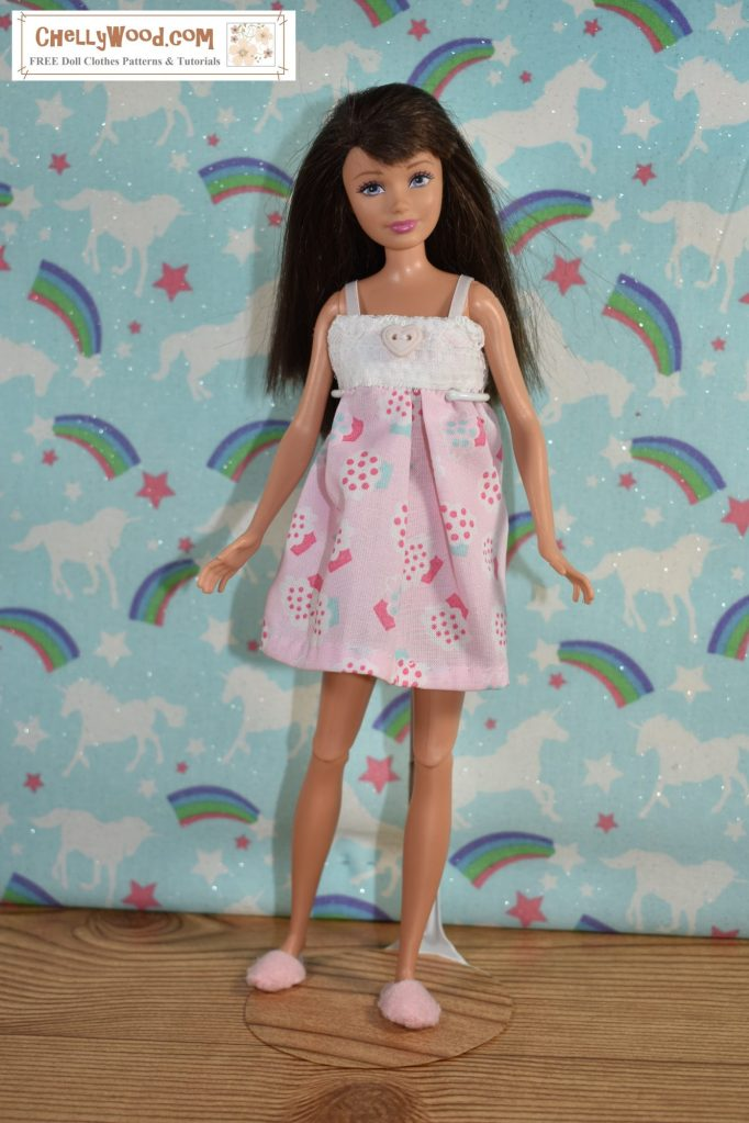 Skipper doll looks extra comfy in her little nightgown made of pink cupcake decorated cotton fabric topped with a lace bodice and satin ribbon straps. She also wears handmade felt slippers. She stands in a bedroom that has unicorn and rainbow wallpaper.