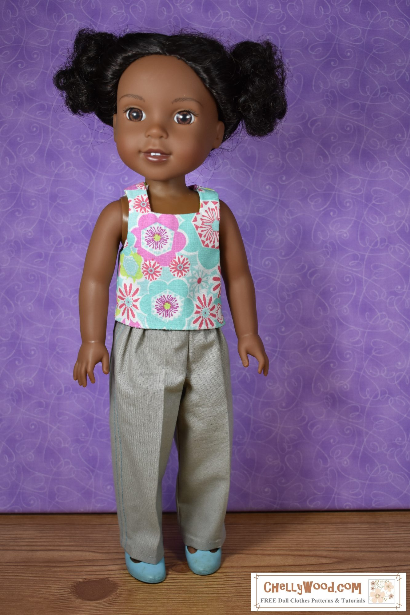 """Please click on the link in the caption to find the free patterns and tutorials for making this outfit. The image shows a Wellie Wisher doll (Kendall from American Girl) wearing a handmade square-neck tank top and khaki pants. Her plastic shoes are MaryJanes. At the bottom of the image, there's a URL for the website where you can print the free pattern for making this entire outfit: ChellyWood.com. The Chelly Wood website's motto is """"free doll clothes patterns and tutorials for dolls of many shapes and sizes."""" Patterns are offered as a PDF download and a MS Word document, for easy printing."""