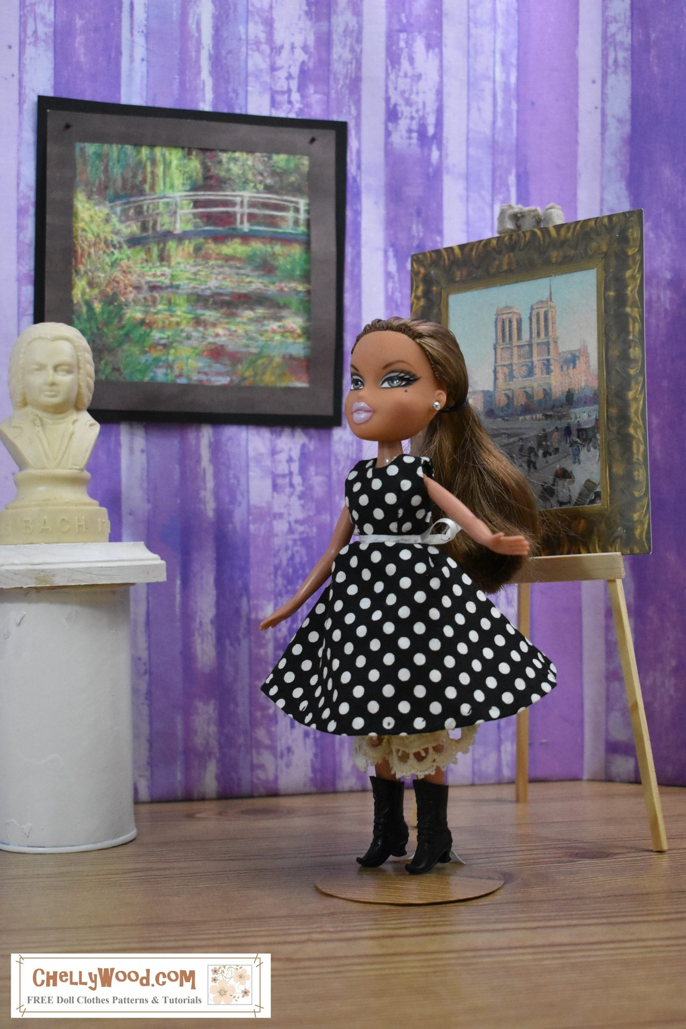 The image shows a Bratz doll wearing an A-line dress with no sleeves and a pair of bloomers. She stands in an art museum diorama displaying tiny paintings on tripod and wall and there's also a bust of Beethoven in the background. Would you like to sew the little black and white polka dotted cotton dress modeled by this Bratz doll? The patterns for this A-line doll dress are free and printable. Just click on the URL given or go to ChellyWood.com to learn more about Chelly Wood's free printable sewing patterns for doll clothes to fit dolls of many shapes and all different sizes.