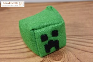 This image shows the Minecraft Creeper character as a hacky sack or footbag cube that has been hand-sewn using felt and the free printable sewing pattern for Minecraft characters found at ChellyWood.com (this is a PDF printable free pattern for a number of minecraft characters including creeper, skeleton, and enderman).