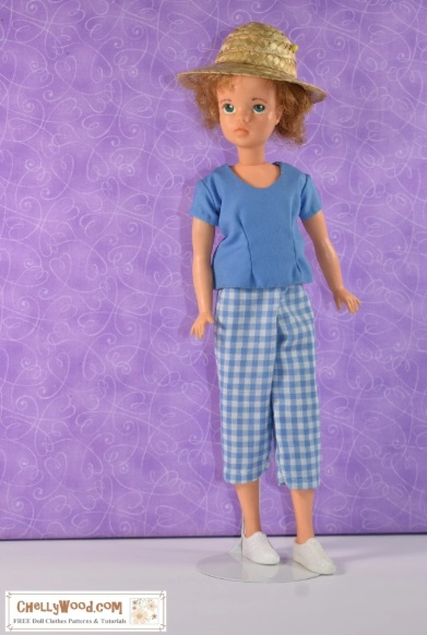 Here we see an image of the vintage Tammy doll from the 1960's wearing a pair of blue gingham plaid pedal pushers (capris) and a matching solid blue shirt with a scoop neck and short sleeves. The pattern for making this outfit, plus free tutorials can be found at ChellyWood.com