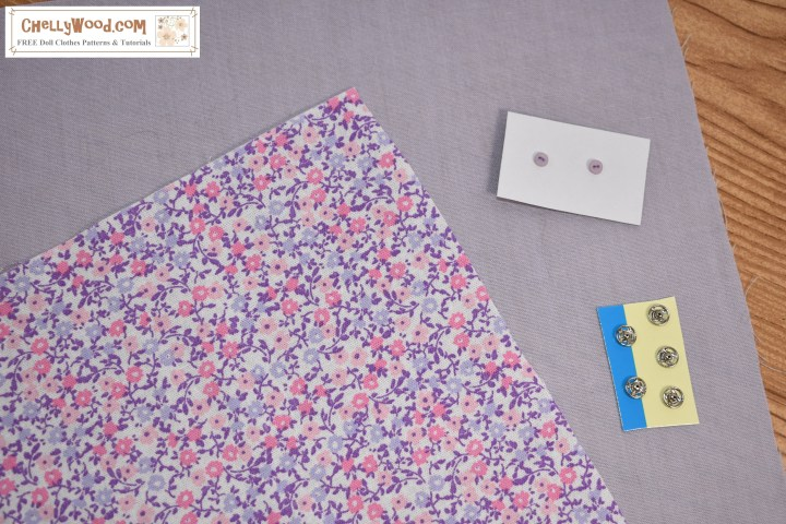 The image shows a swatch of purple and pink floral fabric that measures 10 3/4 inches by 10 3/4 inches, square. It rests atop a swatch of lavender-colored fabric of the same size. There are also two teeny-tiny buttons and five tiny snaps featured in the image. This image is a photo of the tiny swatches of fabric, the buttons, and the snaps that will be sent to the winner of a contest on ChellyWood.com