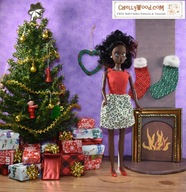 Here we see a lovely Queens of Africa Azeezah doll standing next to a doll-sized fireplace with stockings hanging over it. Behind the doll is a heart-shaped Christmas wreath. To her right is a doll-sized Christmas tree decorated with tiny ornaments. There are teeny-tiny wrapped gifts under the tree. The doll wears a red felt shirt with straps and a bell-shaped above-the-knee skirt made of small-print cotton made of tiny holly-leaf print. To learn more about the Queens of Africa dolls, please go to https://queensofafricadolls.com/