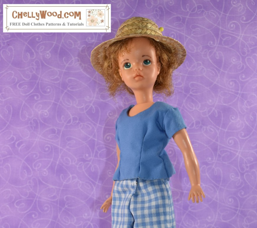 """Here we see a Tammy doll (made by Ideal Toy Corp in the 1960's) wearing a handmade short-sleeved shirt. She stands in a sideways pose like a fashion model and she wears a straw hat like a gardener would wear. The watermark tells you where you can find the free printable PDF sewing patterns for making her short-sleeved shirt with front darts: ChellyWood.com """"free printable sewing patterns and tutorials"""""""
