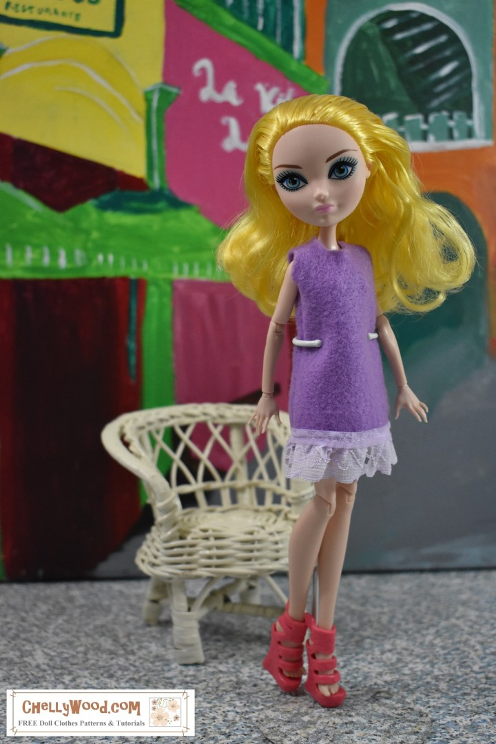 Here we see a yellow-haired Ever After High doll modeling a super easy-to-sew felt doll dress with eyelet trim. The doll stands before a wicker chair with a backdrop behind her that's colorful like a street scene in Jamaica or Haiti. Click on the link in the caption, and it will take you to a page where you can download and print all the free printable sewing patterns for making these doll clothes, along with links to tutorial videos that show you how to make this outfit.