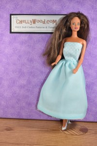 This vintage Teresa (Barbie's Latina friend) doll is wearing a handmade dress in pale blue. It reminds us of Elsa from the Disney movie. The bodice of the dress is even patterned with tiny snowflakes.