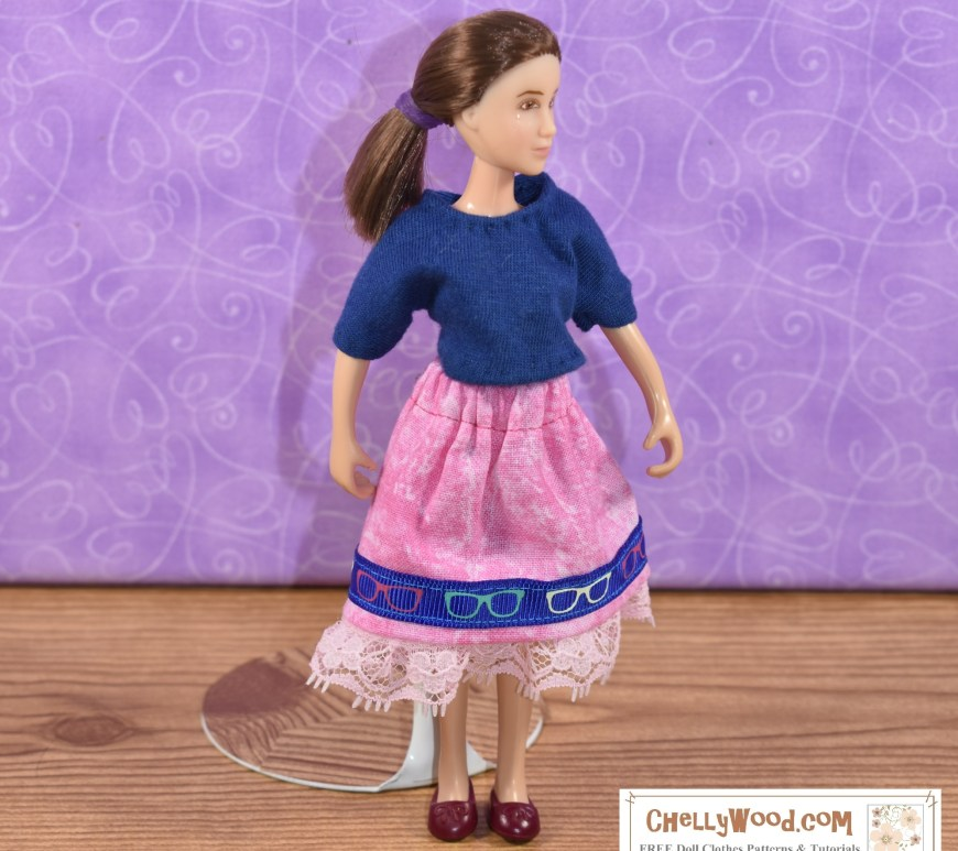 The image shows a Classic Breyer Rider doll in the 1:12 scale (she's 6 inches tall) wearing a handmade T-shirt and skirt. Visit ChellyWood.com for all the free printable PDF sewing patterns and tutorials you'll need to make this DIY doll clothes outfit for your Breyer 6 inch classic rider dolls.