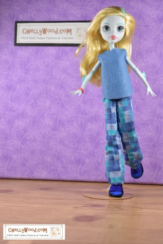 A Laguna Blue Monster High doll seems to be running toward the camera in this studio shot of a Monster High doll in easy to sew handmade doll clothes which include a felt sleeveless shirt and a pair of elastic waist pants. Click on the link in the caption, and it will take you to a page where you can download and print all the free printable sewing patterns for making these doll clothes, along with links to tutorial videos that show you how to make this outfit.