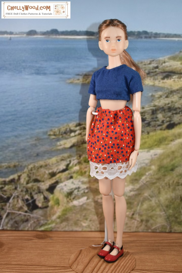 Momoko doll from Sekiguchi stands tall before a beach scene screen. She wears a handmade skirt with lace trim and a short sleeved crop top. Click on the link in the caption, and it will take you to a page where you can download and print all the free printable sewing patterns for making these doll clothes, along with links to tutorial videos that show you how to make this outfit.