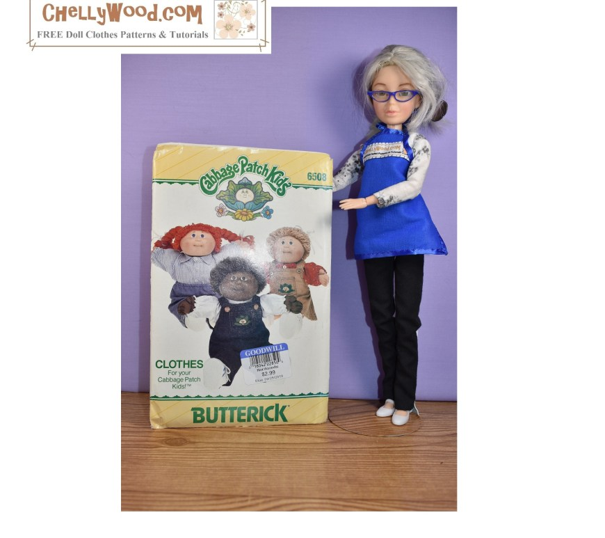 The image shows the Chelly Wood doll (a Spin Master Liv doll with a grey haired wig) holding up a Cabbage Patch doll clothes pattern from the 1980's. The image has a matching blog post suggesting where you can find patterns to fit your Cabbage Patch dolls (or similar-sized baby dolls in the 14 inch, 15 inch and 16 inch size range). Visit ChellyWood.com to read the article on how to get patterns for your large baby dolls and Cabbage Patch dolls.