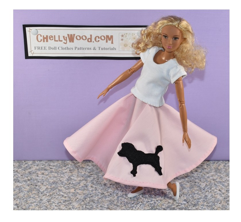 The image shows a Made to Move Barbie modeling a handmade 1950's style poodle skirt in pink with a black silhouetted poodle sewn to the fabric. In this photo, the camera seems to be above the doll, and she's looking up at it. She leans back as if laughing. She also wears a handmade T-shirt and flat white shoes. This Barbie has a dark complexion with blond curly hair. The website in the background is ChellyWood.com, a site that offers free printable sewing patterns for making doll clothes to fit dolls of many shapes and all different sizes.