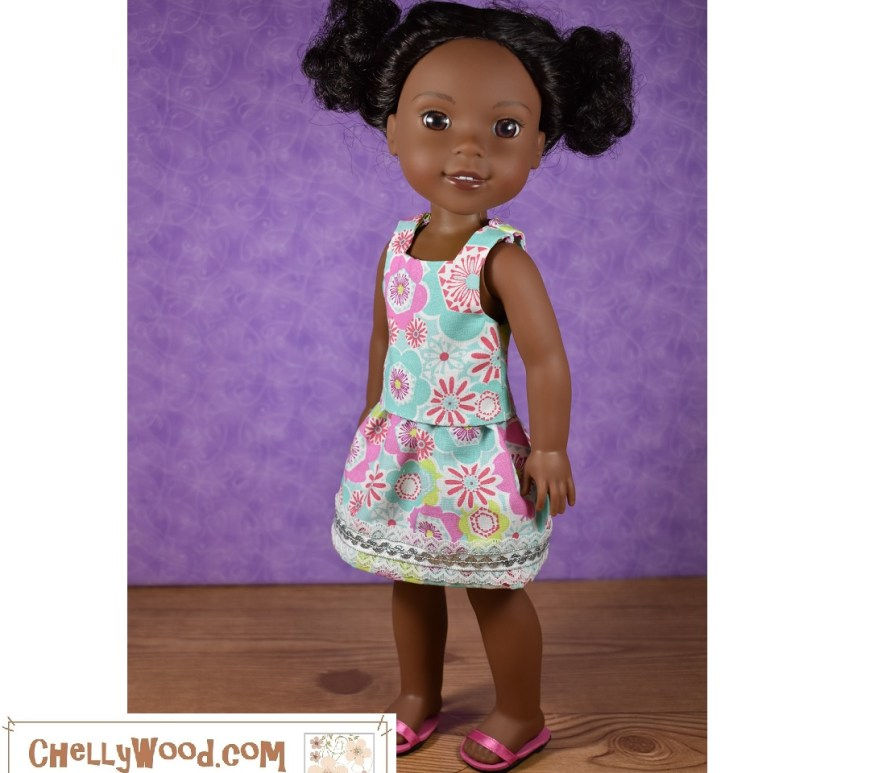 The image shows a Wellie Wishers doll from American Girl modeling a handmade skirt and sleeveless summer shirt. The skirt has an elastic waist and is trimmed with both white lace and a silver strand of rickrack. The shirt has a square neck and straps. The fabric is a cotton print with a 1970's style floral design in colors of turquoise, pink, and white.