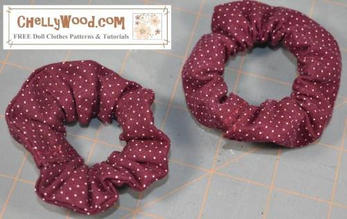 Please click on the link in the caption to navigate to the page where you can download and print your free PDF sewing patterns for making hair scrunchies (or scrunchie hair ties / scrunchy hair ties). The image shows two scrunchie hair ties or hair elastics made with a burgundy-colored fabric that has a dotted-swiss style of polka dots on the fabric. Free patterns and tutorial videos are available at ChellyWood.com