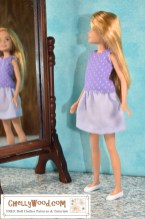 Click on the link in the caption for this image, to locate the free printable PDF sewing patterns and tutorial videos for making this outfit. The image shows Barbie's little sister Stacie wearing a handmade tank top that's purple with white polka dots over a short lavender-colored skirt. The little doll peers into a standing mirror, and in the mirror's reflection we see Stacy's smiling face. It looks like she's very pleased with her handmade doll clothes! If you'd like to make this summer shirt and short skirt doll clothes set for Stacie or another 8-inch or 9-inch doll (like Lottie dolls, Bratz dolls, Mego female action figures, or similar sized dolls), visit ChellyWood.com where you can find the free printable PDF sewing patterns and tutorial videos that will show you exactly how to sew these doll clothes.